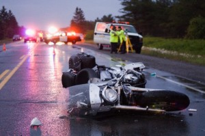 29 Jun 2008, Nairn and Hyman, Ontario, Canada --- Accident on the Trans Canada Highway, near Nairn Centre, Ontario, Canada on June 29, 2008. The motorcycle driver was an off duty police officer who had a fatal head on collision with an oncoming vehicle. --- Image by © Thomas Fricke/Corbis